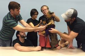 The Rogue Theatre ensemble members exploring FST puppets.