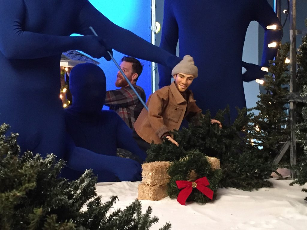 Andy puppet moves a Christmas tree