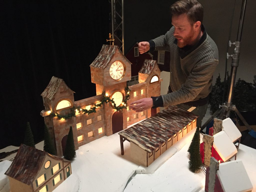Puppet Set Designer John Sundling puts the final touches on Santa's Workshop