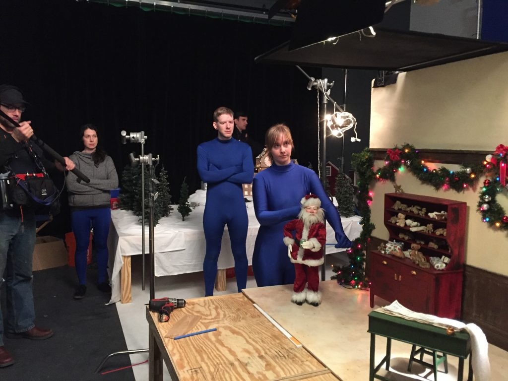 Laura Collard puppeteers Santa, watched by Dylan Rohman and Vanessa Romanoff